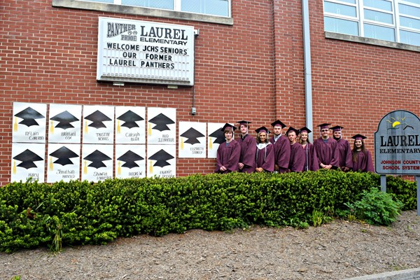Former Laurel Elementary seniors posing in front of the school
